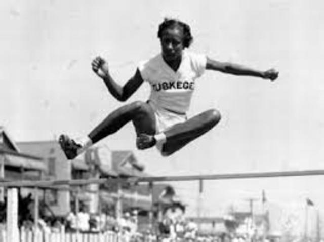 Alice Coachman wins an Olympic gold medal