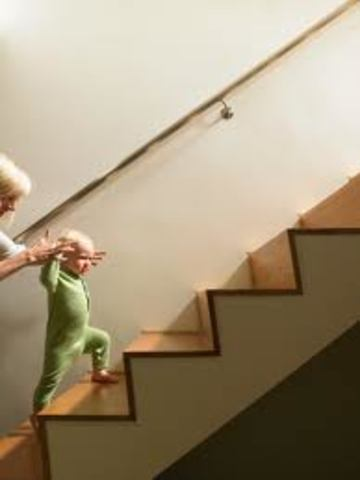 Walks up stairs with help