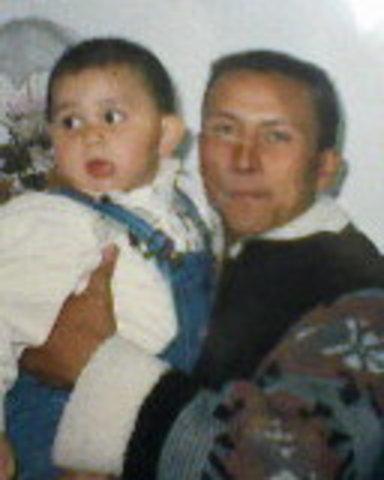 Camilo de pequeño y su padre.