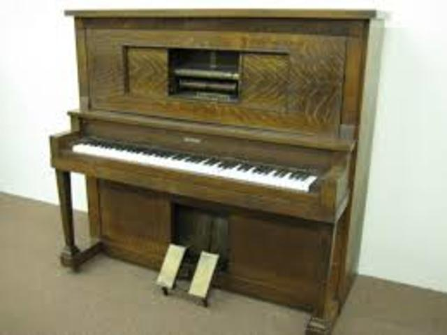 Player piano using electricity