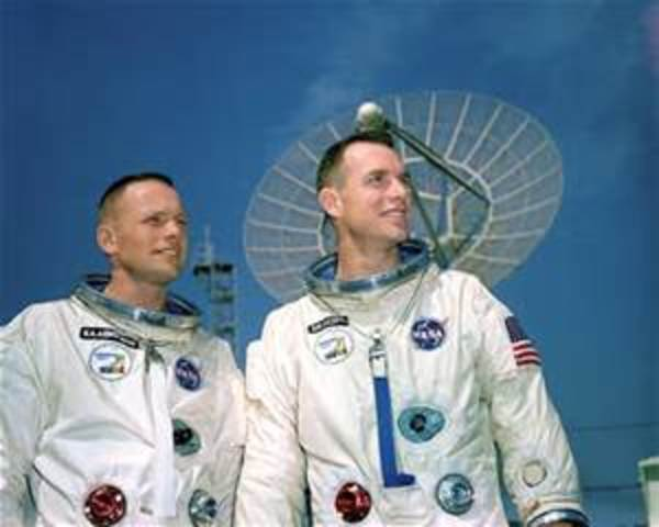 Gemini astronouts Neil Armstrong and Scott David perform the first critical orbital docking