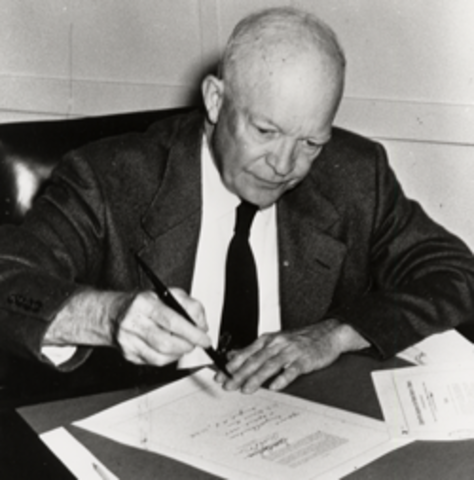 Eisenhower signs the act creating NASA