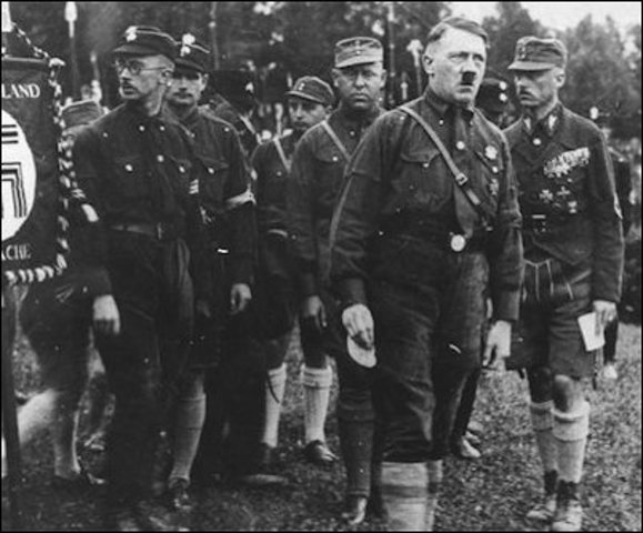 Hitler re-founds the Nazi party.