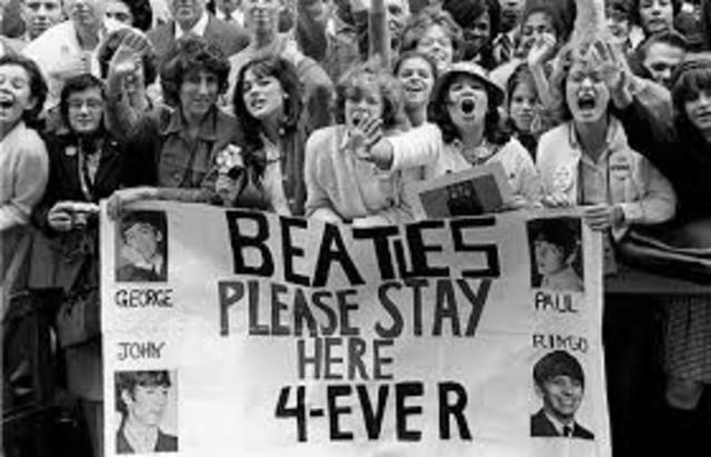"""""""Beatlemania"""" breaks out in the United States, marking the beginning of the British Invasion"""