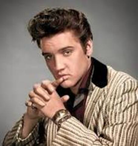 """Elvis Presley begins his recording career at RCA Victor and his reign as the """"King of Rock 'n' Roll""""."""