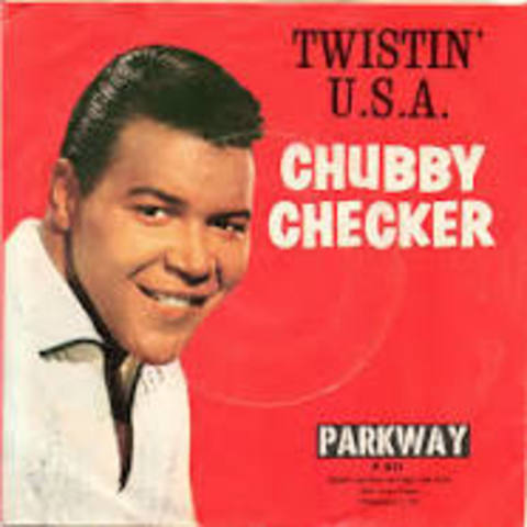 """Chubby Checker's recording of """"The Twist"""" sets off a spate of dance records and crazes."""