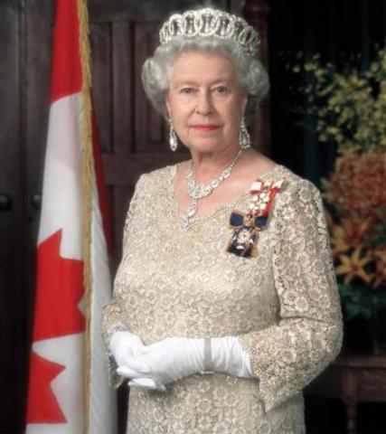 Queen Elizabeth II signs a document the Australia Act