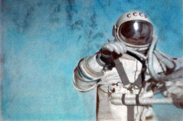 Alexei Leonov performs the first spacewalk