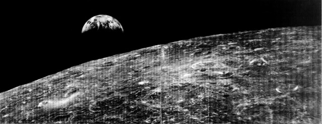 Lunar Orbiter 1 takes first photograph of the earth from the distance of the moon