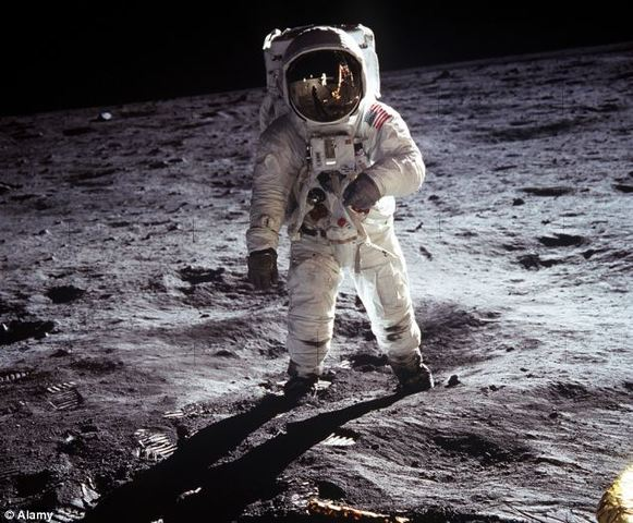 Neil Armstrong and Buzz Aldrin become the first men to walk on the Moon