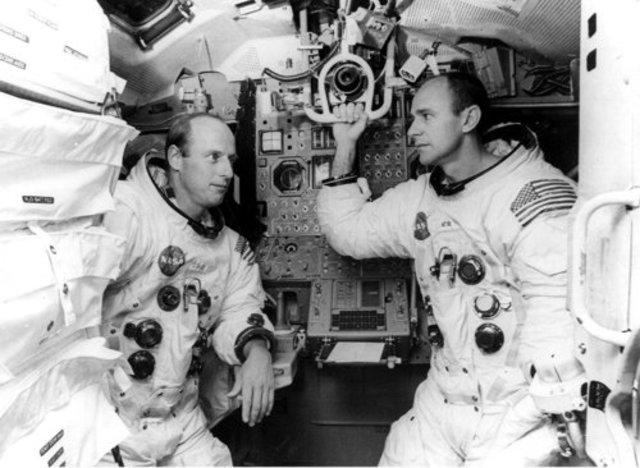Pete Conrad and Alan Bean perform the first precision lunar landing