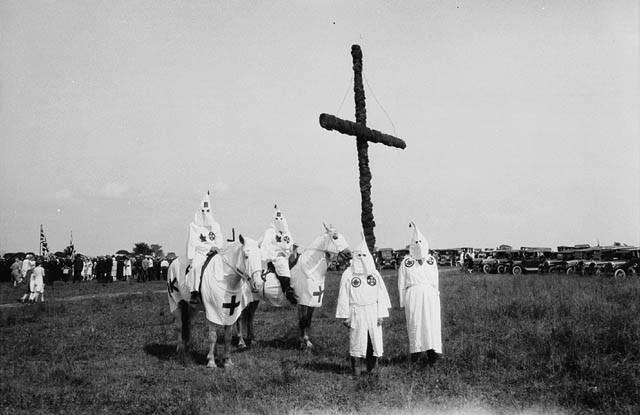 Ku Klux Klan members in Maine burn crosses in hostility to French Americans