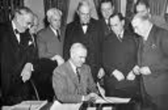 Truman Signs the Marshall Plan