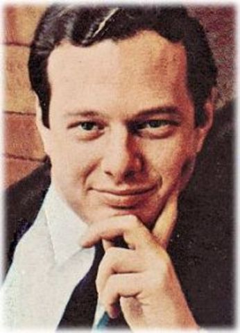 Manager Brian Epstein Listens to Group