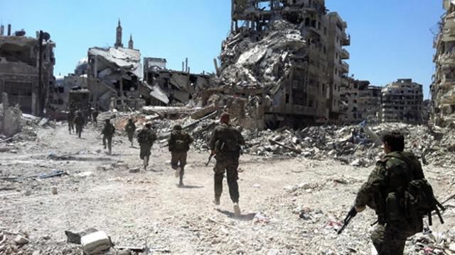 Rebeldes y Régimen en Homs.