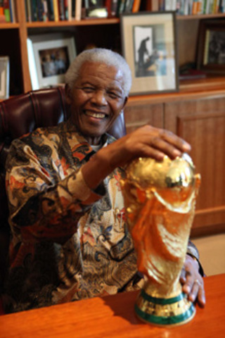Mandela gets presented with the FIFA world cup trophy
