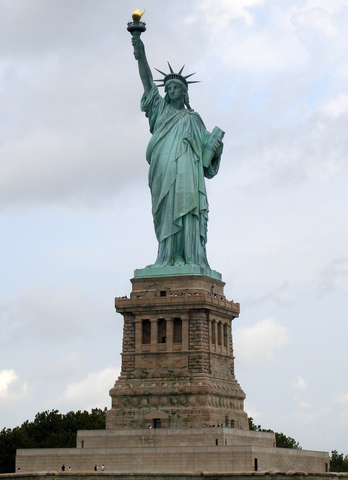 President Grover Cleveland unveils the Statue of Liberty.