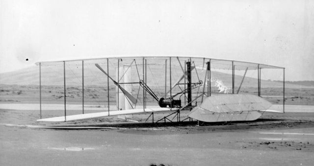 Wilbur and Orville Wright fly a gasoline-powered flying machine