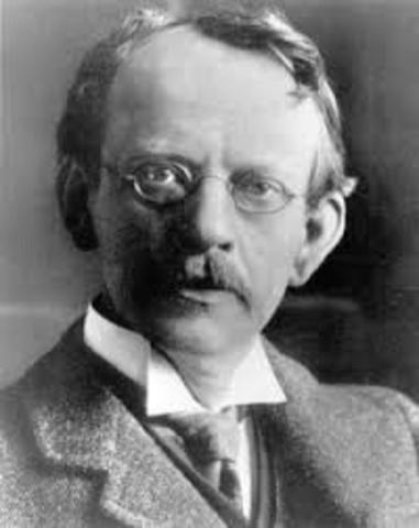 J. J. Thomson discovered electrons which were small negatively charged particles.