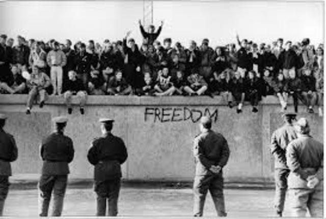 Germans Dismantle Berlin Wall
