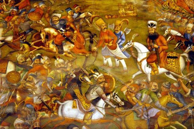 The Ottoman and Safavid armies clash at Chaldiran