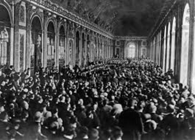 The Treaty of Versailles officially ends WWI