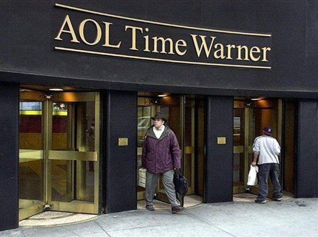 America Online buys Time Warner