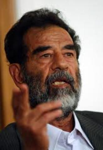 Hussein defies