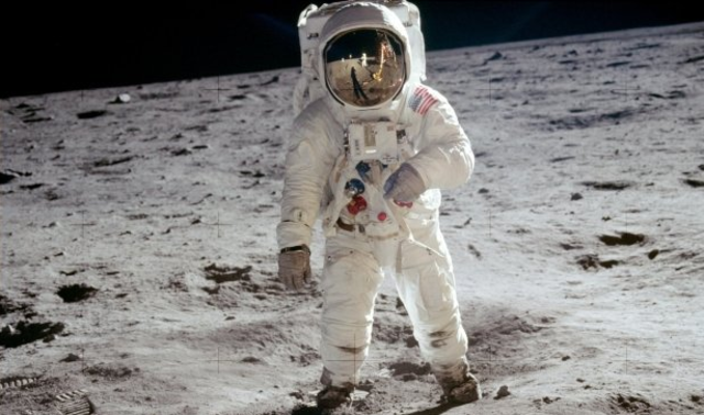 Neil Armstrong puts man on the moon