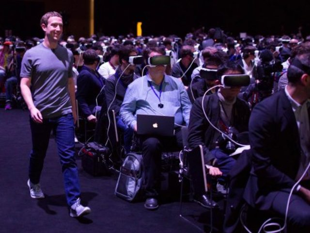 Here is a picture of Mark Zuckerberg walking through a room of people with VR headsets on