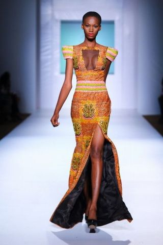 Asagai comes to see Beneatha from Africa and gave her a dress