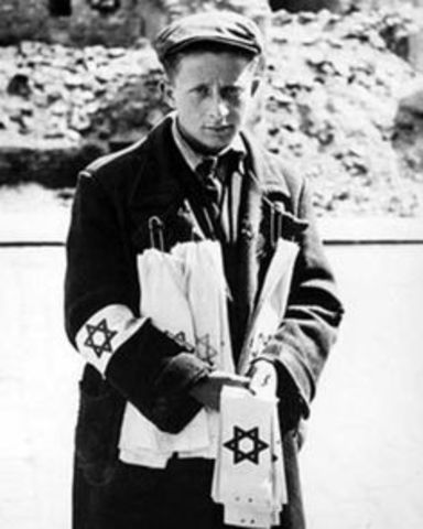 Polish Jews are ordered to wear Star of David armbands
