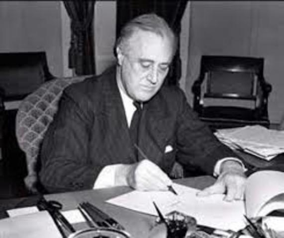 Roosevelt signs the Lend Lease Act