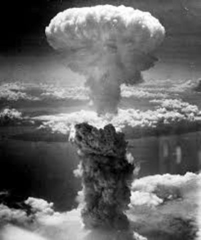 """The B-29 bomber Bockscar drops the second atomic bomb """"Fat Man"""" on Nagasaki."""