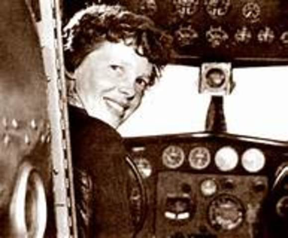 Amelia Earhart completes first solo nonstop transatlantic flight by a woman