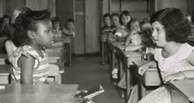 Brown v. Board of Education.Supreme Court decision ends racial segregation in schools