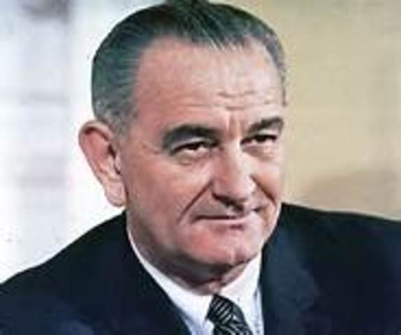 President Kennedy is assassinated and succeeded  by his vice president, Lyndon B. Johnson.