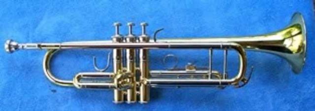 Began playing trumpet