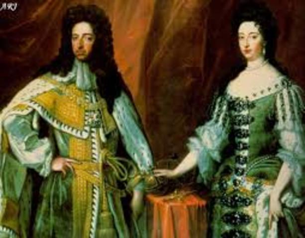 William and Mary become the King and Queen of England (Glorious Revolution).