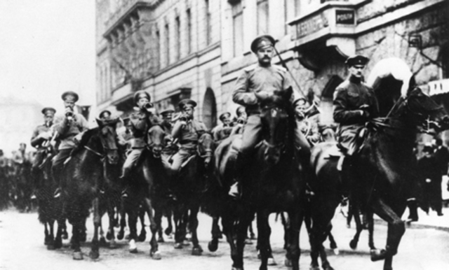 The February Revolution begins with strikes, demonstrations, and mutinies in Petrograd