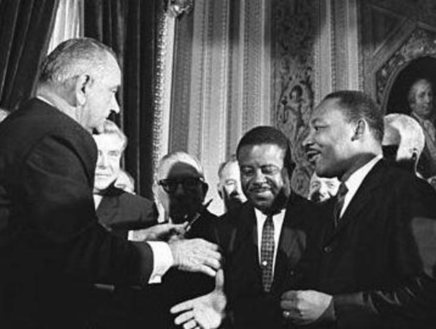 The Voting Rights Act of 1965 is signed into law by the President