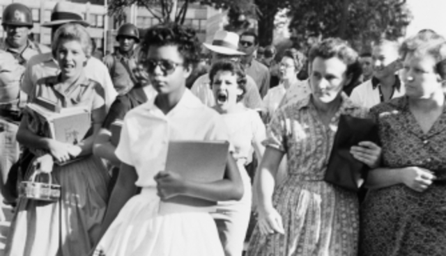 "The ""Little Rock Nine"" integrates Central High School"