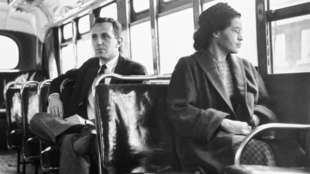 Rosa Parks refuses to give up her bus seat to a white man