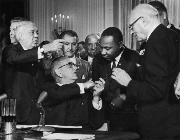 The Civil Rights Act of 1964 is signed into law by the President