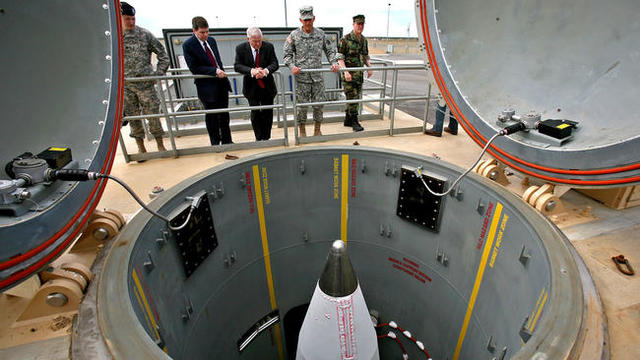 President Bill Clinton signs the National Missile Defense Act