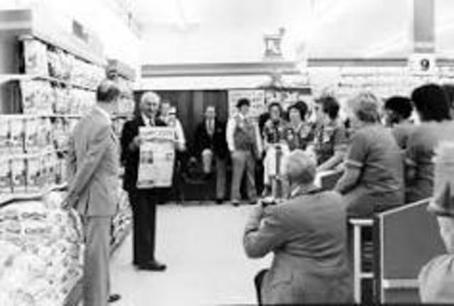 Sam Walton Opens First Walmart