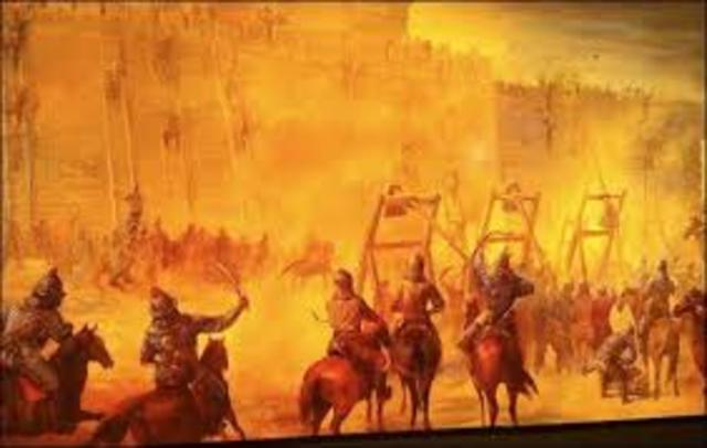 Mongols burn Baghdad
