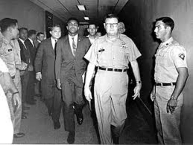 Boxer Muhammed Ali refuses military service