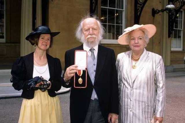 Knighted by Queen Elizabeth II