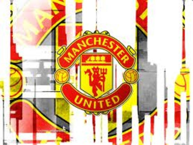 Signs with Manchester United